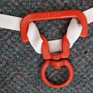 3. Push the swivel end through the loop in the rope and slide the rope up against the shoulders
