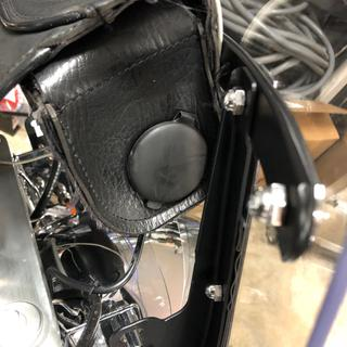 Mounted in leather handlebar bag