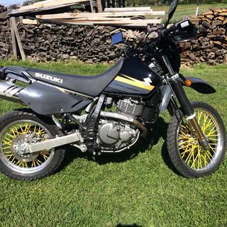 these yellow spokets brighten up this Suzuki DR650
