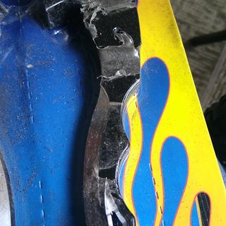 There are deep scrapes and gashes in the metal.
