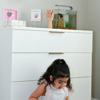 We love the design and sleekness of this dresser. The drawers are so smooth