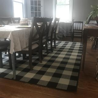 Nice rug, definitely needs a rug pad. Looks really great, nicer than the stock photos.