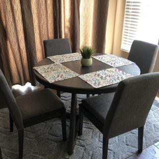 Dinning room table and chairs with carpet