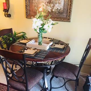 I absolutely love my new dining room table and chairs! It is a beautiful design.