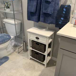 The Oslember Accent Table fits perfectly in the empty space under the towels in our bathroom!