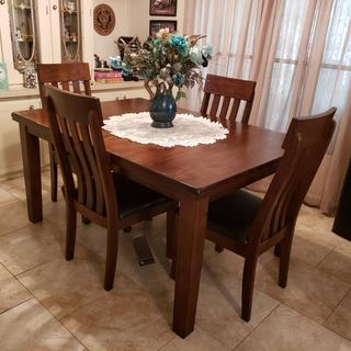 Fits perfect.  Solid, well made table and the chairs are nice and sturdy and do not wobble.  Love!