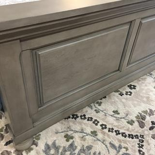Close up of Lettner footboard shows the true grey color.  Shown on grey,sage, creme and blue rug.