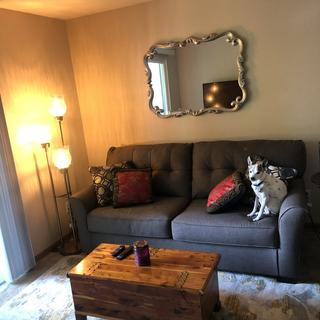 Mirror looks beautiful above my Tibbee couch and Ashley floor lamp.
