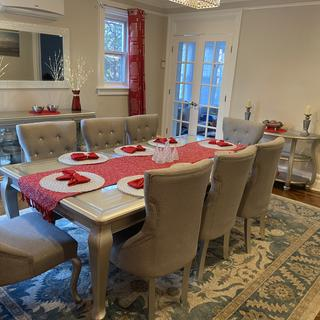 The full dining room set, server and console table decorated for the holidays.