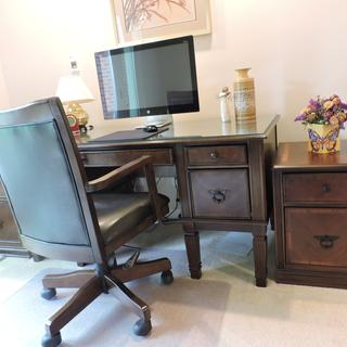 New file cabinet with our six-year old matching cabinet,m desk and chair
