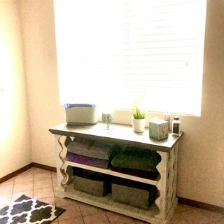 Not the best picture with the backlight but I love this beautiful table. Easy to put together too!