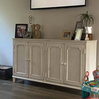 this piece is perfect for underneath our TV! It doesn't have holes in the back for cords though.