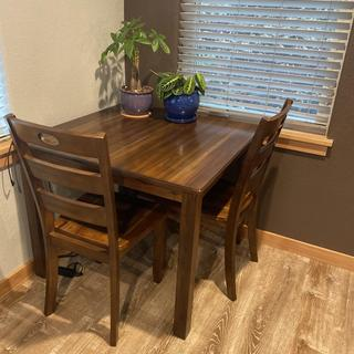 Table for 2 or 4! Fits flush in the corner and ready to pull out for dinner with a few friends:)