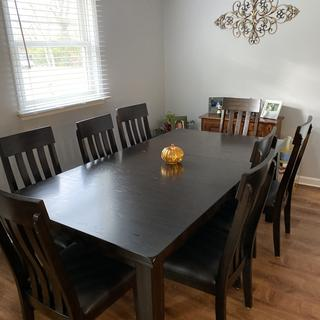 Table fully extended with eight chairs.