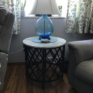 Looks as advertised a great end table especially for a small space