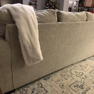 Back view of sofa-nicely upholstered so you don't need to have up against a wall to hide anything.