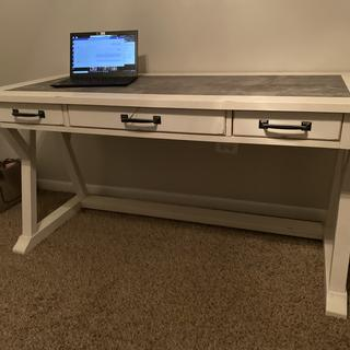 Very solid massive beautiful piece. Love this desk!