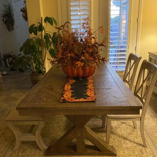 The table fits perfectly in our dining room.