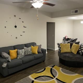 I added yellow pillows to brighten up the room.