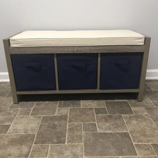 Really sturdy -well made bench! I added blue cloth bins for a pop of color! Easy to assemble also!