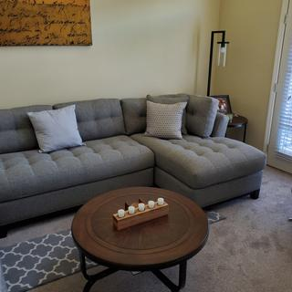 Coffee table and one of the end table is to the right.