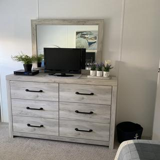Winter home spare bedroom absolutely love the dresser.