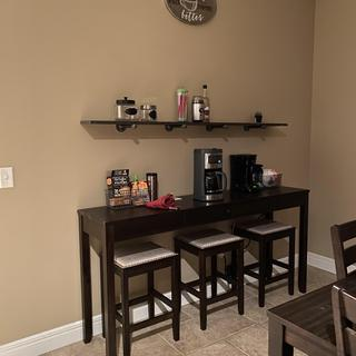 Works perfectly in the space as a coffee bar and extra seating when needed. Great buy!