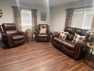 We love our new brown rocking recliners and matching loveseat with no console taking up the middle