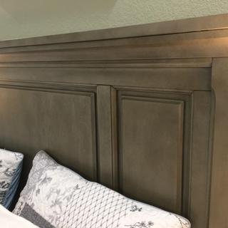 Headboard on sage green wall back drop.  May give appearance of green from reflection.