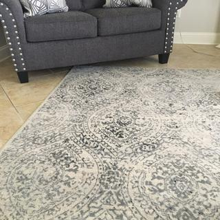 gray and white rug no beige like the picture on line had to put in another area in my house..