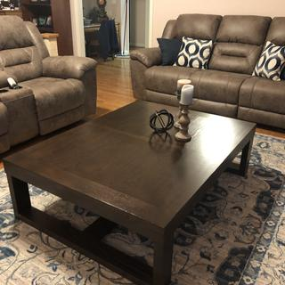 Watson coffee table paired with sofa and loveseat from Ashley furniture as well
