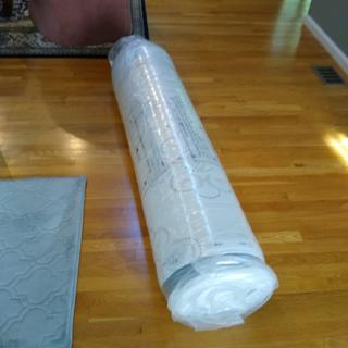 Rolled up in double plastic wrap