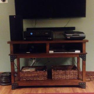 This Murphy Sofa/Console Table fits perfectly underneath our 55 inch T.V.