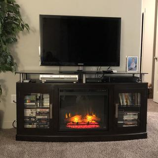 Love it! Heat or no heat it is great! Adds so much ambiance  to room! Stores lots of movies.