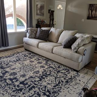 Love the couch. Fits perfect in my living room. Added the blue pillows.