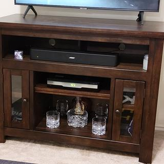 Nice tv stand. Compact and we'll designed, though not as well built.