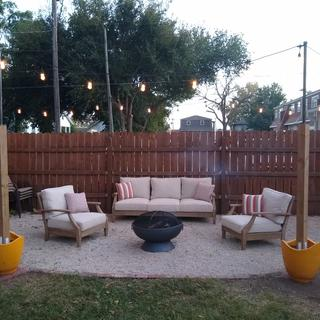 Clareview sofa and chairs in a gravel fire pit area.