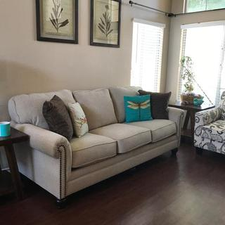 All pieces here are from Ashley! Sofa, tables, chair and even the wall art!