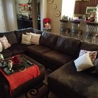Add some throw pillows and get the Ottoman for a make shift coffee table