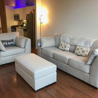 We were so excited to take a picture of our new Pierin Sofa and Chair set that we forgot to remove the tags!