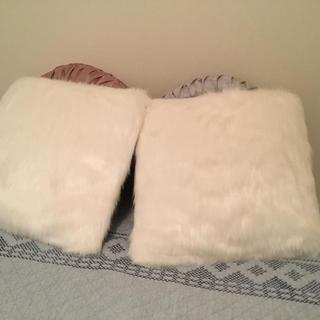 White furry pillows