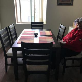 My mom loving my table