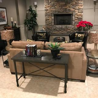 Sofa console in fireplace den