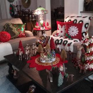 My table decorated for Christmas. We absolutely love it. It is large and heavy but we knew that when we bought it. Had it two mo ths now woth no problems.