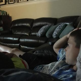 Our older son relaxing on the most comfortable couch ever