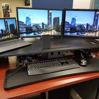 """Two different 22"""" monitors , front. Mounted om Monoprice Workstream desk  Converter 48"""""""