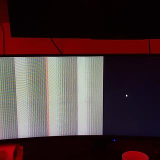 This is an image from the first monitor. I tried different cables and inputs and nothing fixed it.