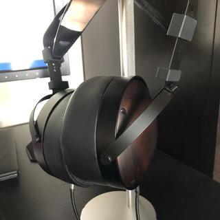 M1060C headphones mounted on aluminum stand.