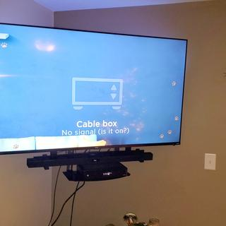 """Finished product mounted with 65"""" Roku TV"""