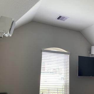 Left and right speakers on mounts